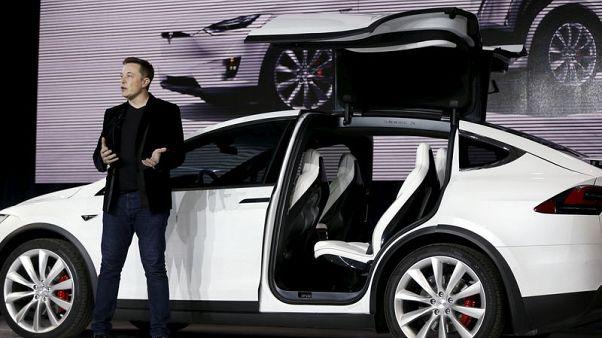 U.S. regulators sue Musk for fraud, seek to remove him from Tesla