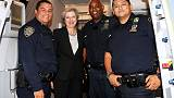 An Englishwoman in New York -  May poses with police to help stranded aides