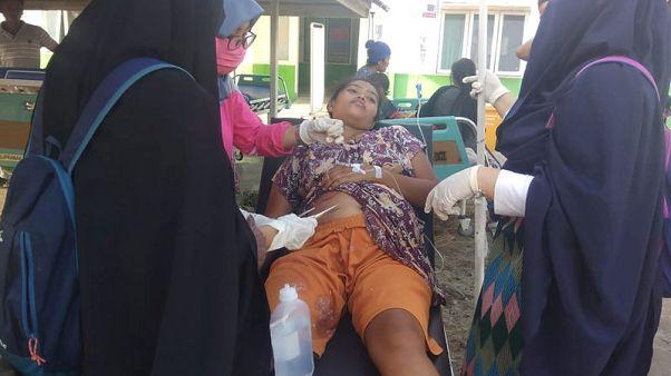 Quake strikes off Indonesia, bringing down 'many buildings'