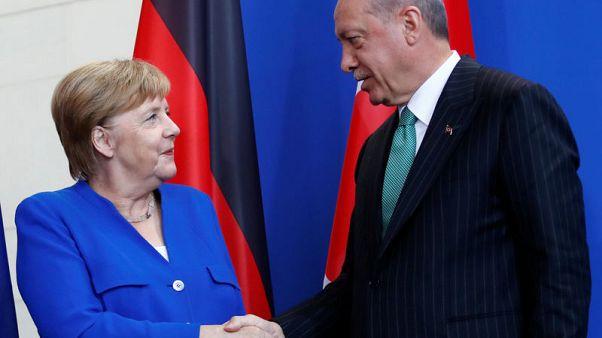 Turkey's Erdogan, in Berlin, pledges EU visa push