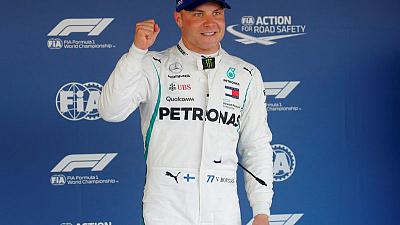 Motor racing - Mercedes weighing up team orders after Bottas pole