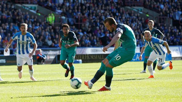 Kane double at Huddersfield sends Spurs fourth