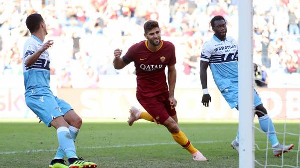 Fazio goes from villain to hero as Roma win derby