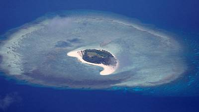 U.S. warship sails near disputed South China Sea islands - U.S. official