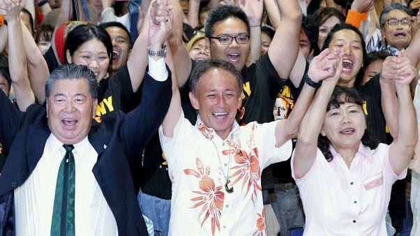 Son of U.S. marine elected Okinawa governor on anti-U.S. base platform