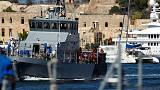 Migrants - and a dog - disembark in Malta after long wait at sea