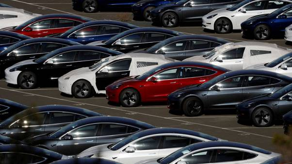 Tesla shares jump on Model 3 numbers, Musk deal
