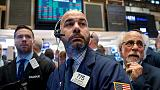 Global stocks dip amid Italy angst, but tech lifts Dow