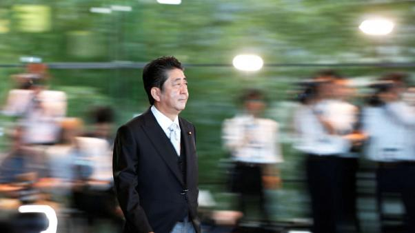 Japan PM Abe keeps allies in key posts, just one woman in cabinet