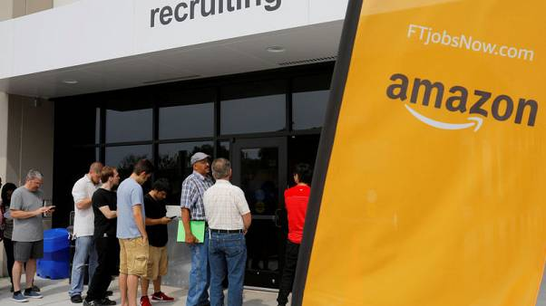 Amazon raises minimum wage to $15, urges rivals to follow
