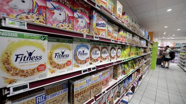 France adopts food bill, retailer says will lead to price rise