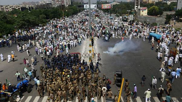 Indian police fire tear gas, water cannon to break up farmers' protest