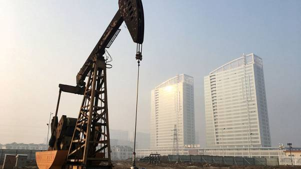 Oil prices dip on rising U.S. supply, but Iran sanctions still loom