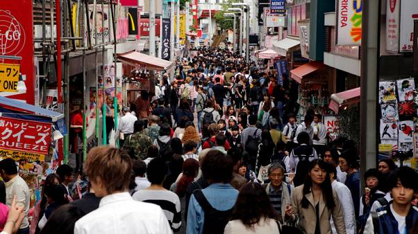 Japan's output exceeds capacity the most in decade, inflation still a riddle