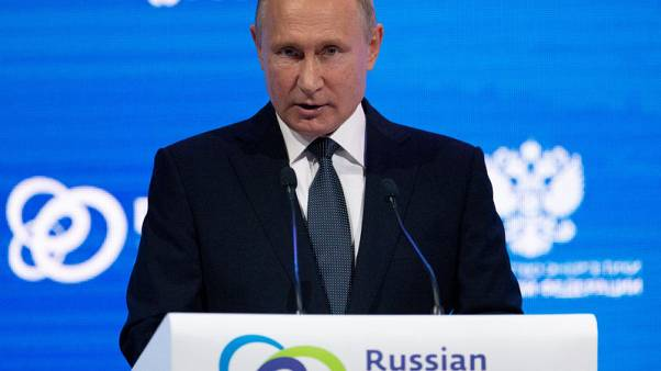 Russia's Putin urges end to Washington political infighting