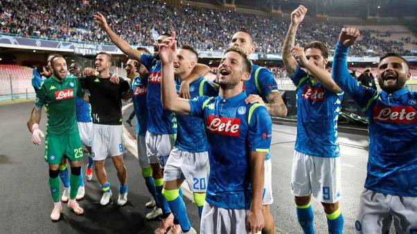 Late winner sends Napoli top with victory over Liverpool