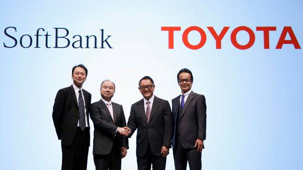 Toyota, SoftBank team up to develop self-driving car services