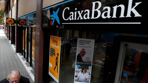Spanish court to investigate Caixabank's purchase of BPI