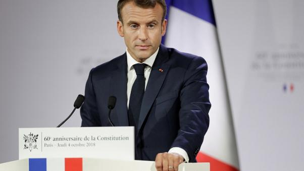 In political storm, Macron wraps himself in de Gaulle's constitution, style