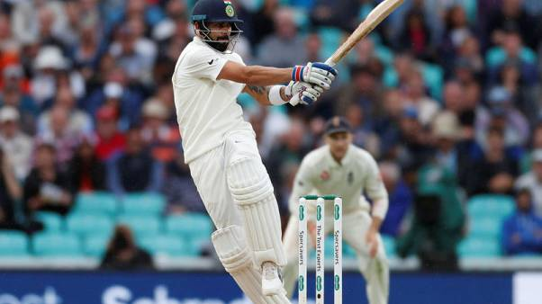Kohli reaches 24th ton as India pass 500 against West Indies