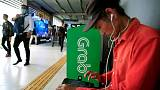 Exclusive: SoftBank nearing $500 million investment in ride-hailing firm Grab - sources