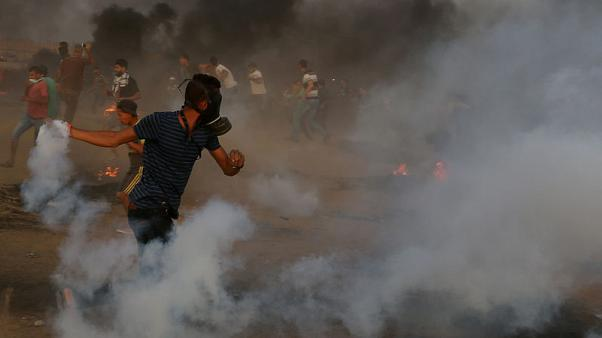 Israeli troops kill Palestinian child and one other protester at Gaza border - medics