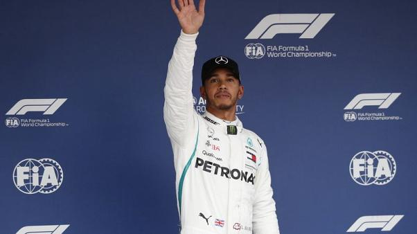 Hamilton storms to 80th pole in Japan, Vettel eighth