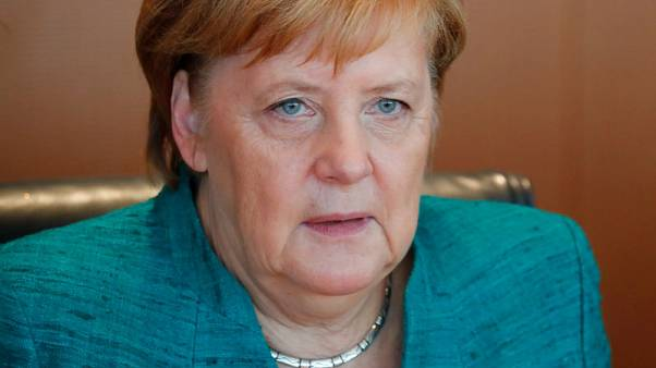 Merkel calls for end to conservative in-fighting to halt poll slide