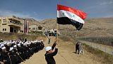 Golan Druze gather at border, chanting loyalty to Syria's Assad