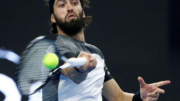 Tennis - Basilashvili sets up Beijing showdown with Del Potro