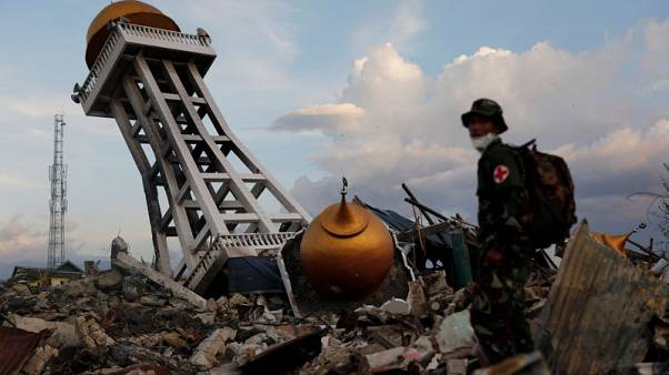 Anger, dismay as Indonesia says search for quake victims to end