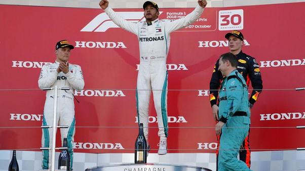 Motor racing - Hamilton wins in Japan, Vettel sixth