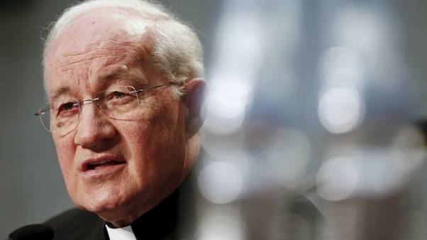 Top Vatican cardinal accuses papal critic of 'calumny and defamation'