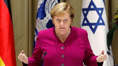German conservatives back Merkel bid for party leadership