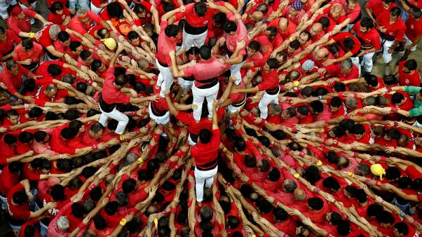 Human tower builders in Catalonia kick off with pro-independence protest