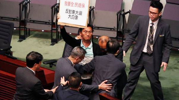 Hong Kong lawmakers walkout over media 'persecution' at city leader's policy address