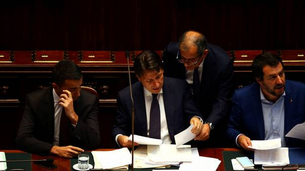 Italy's government digs in over budget plan as pressure rises