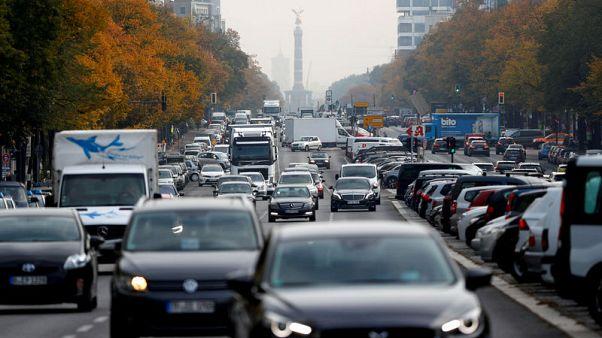 Merkel backs EU climate deal over car lobby's protests