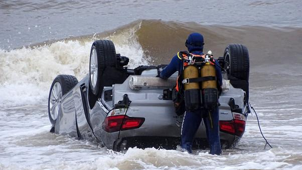 Two dead in France after flashfloods wash car into sea