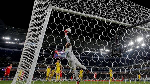 Soccer - Olsen's super save helps Sweden hold Russia to 0-0 draw