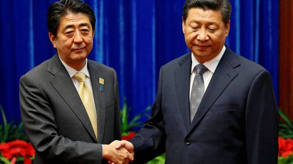 Japan's Abe pursues China thaw as U.S-Beijing ties in deep freeze