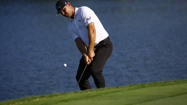 Golf - Woodland ties course record to soar to CIMB Classic joint lead