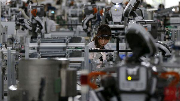 Japan manufacturers' mood rises, trade worries weigh on outlook - Reuters Tankan