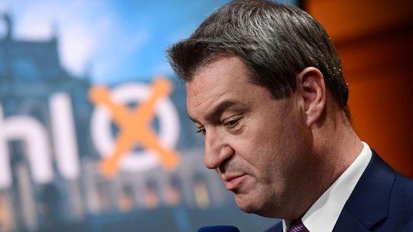 Humiliating losses in Bavarian election shake Merkel's coalition