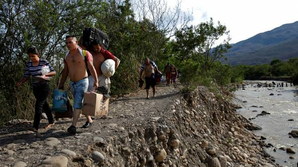 Fleeing hardship at home, Venezuelan migrants struggle abroad, too
