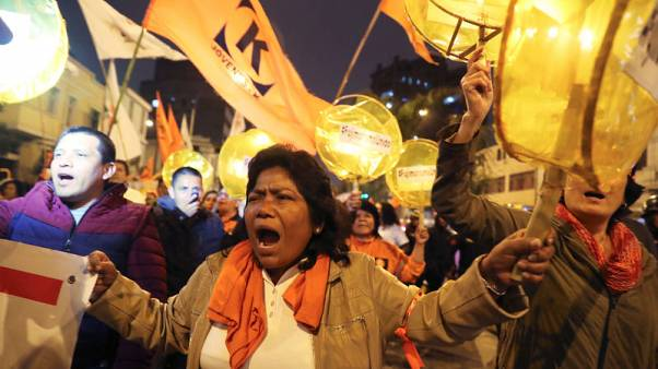 Peru detains opposition leader's top advisers at political rally