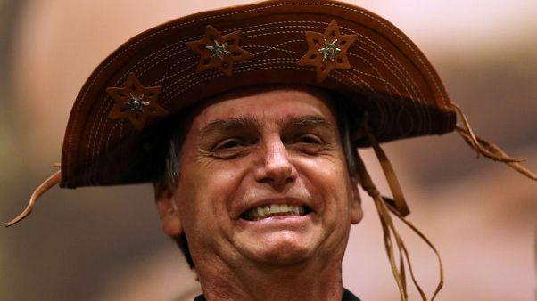 Brazil far-right candidate Bolsonaro holds commanding lead