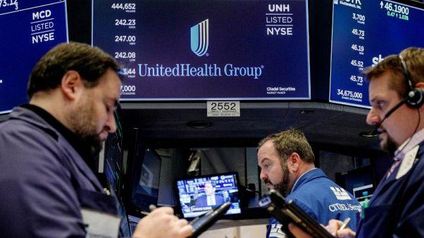 UnitedHealth tops earnings estimates, raises 2018 forecast