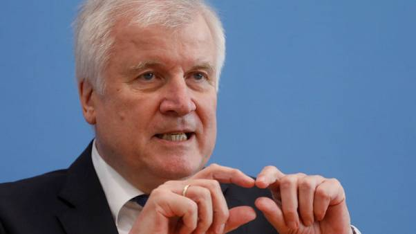 German CSU leader Seehofer wants Merkel coalition to work