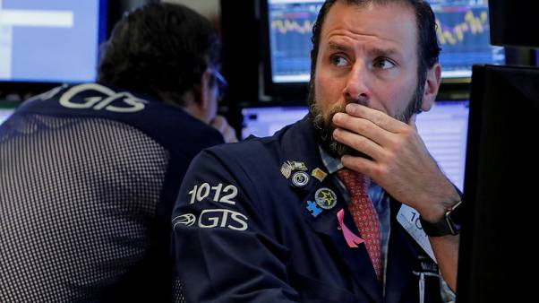Stocks wobble as Wall Street cuts losses; oil off after U.S. data